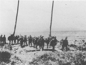 "Battle of Edson's Ridge - Japanese troops from the ""Aoba"" Regiment march along the shore of Guadalcanal shortly after landing during the first week of September 1942."