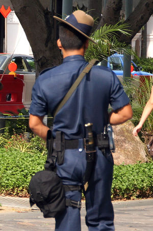 Kukri - A Gurkha officer of the Gurkha Contingent, Singapore Police Force patrols around Raffles City during the 117th IOC Session. He wears the distinctively tilted Hat Terrai Gurkha, the kukri can be seen attached to the back of his belt