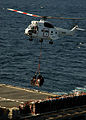 Helicopter conducts a vertical replenishment.jpg