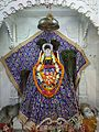 Idol of the presiding deity at Shree Shyam Mandir, Guwahati.jpg