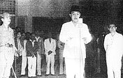 Sukarno proclaiming Indonesia's independence, with Hatta on the right