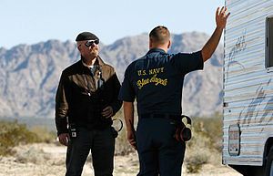 Jamie Hyneman - Hyneman and a Blue Angels team member at Marine Corps Air Station Yuma prepare for the Sonic Boom Sound-off episode in 2009.