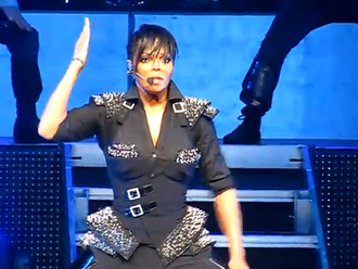 "Janet Jackson's Rhythm Nation 1814 - Jackson performing the album's title track, ""Rhythm Nation"", during her 2011 Number Ones, Up Close and Personal tour."