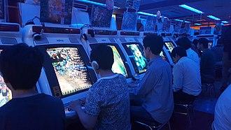 Shoot 'em up - Japanese players at a shoot 'em up arcade in Akihabara, Tokyo. (2017)