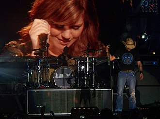 Don't You Wanna Stay - Kelly Clarkson is seen on a big screen behind Jason Aldean.