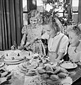Jean Devereux cuts the cake in her house in Pinner, Middlesex, on Christmas Day 1944. D23009.jpg