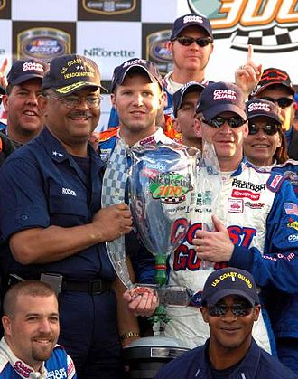 Jeff Burton - Stephen Rochon and Jeff Burton hold the victory trophy from 2006 Nicorette 300