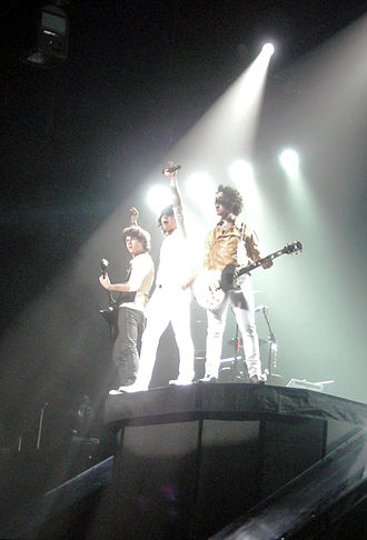 Boy band - Jonas Brothers are described as pop boy band