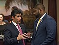 Jose Oliva and Byron Donalds confer on the House floor.jpg