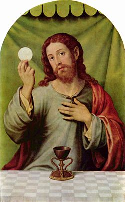 Oil painting showing Jesus at the Last Supper. He is shown seated behind a table, looking directly at the viewer while raising a communion wafer in his right hand, and laying his left hand on his heart. The cup of Communion is on the table, placed centrally in the picture.