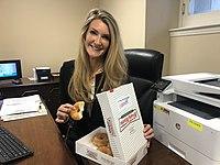 Kelly Loeffler with Krispy Kreme donuts.jpg