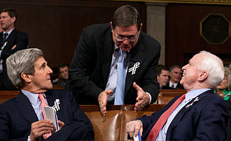 Michael C. Burgess - Rep. Burgess speaks to Senators John Kerry and John McCain in the House Chamber of the U.S. Capitol before the 2011 State of the Union Address