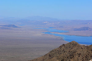 Cottonwood Valley (Arizona and Nevada) - View slightly east of true-north. The expanse of the valley on left is Nevada. The view is from the peak Spirit Mountain (Nevada) of the Newberry Mountains with Lake Mohave in the background.