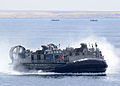 Landing Craft, Air Cushion 84 approaches the well deck of amphibious transport dock ship USS New York (LPD 21) after pre-staging 24th Marine Expeditionary Unit assets in Cap Draa, Morocco, April 9, 2012, before 120409-N-NN926-041.jpg