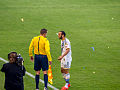 Landon Donovan argues with referee's assistant.jpg