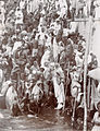 Large crowd of people at a bathing ghat along the Ganges (c. 1905-1906).jpg