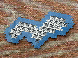 Tessellation - A wall sculpture in Leeuwarden celebrating the artistic tessellations of M. C. Escher