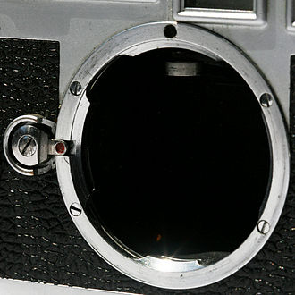 Leica M mount - Female part (body). The mechanical sensor seen inside the top of the mount is the rangefinder coupling arm.