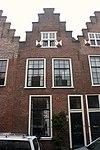 foto van Wevershuisje met trapgevel. In de top een venster met houten kruiskozijn en luikjes