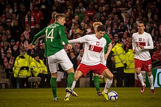 Robert Lewandowski (center) and Arkadiusz Milk (right) playing for Poland in a friendly match against the Republic of Ireland, in 2013. Lewandowski and Milik vs Ireland 2013.jpg