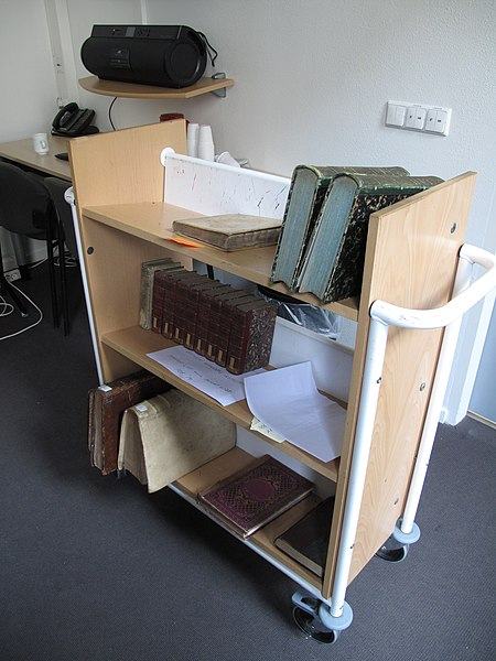 File:Library cart with historical travelogues, Maastricht University Library.jpg