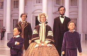 Abraham Lincoln Presidential Library and Museum - Lincoln Family in the Museum Entry Plaza. John Wilkes Booth can be seen watching them.