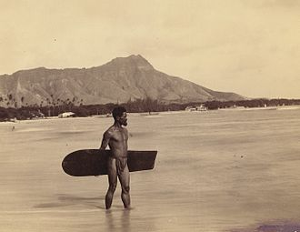 Alaia - 1898 photo of a Hawaiian surfer at Waikiki Beach, carrying what was described as one of the last alaia boards at the time