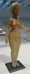 statuette of a standing naken woman, possibly the Great Goddess of Babylon