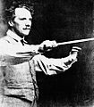 Luigi Von Kunits with conducting baton (cropped).jpg