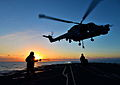 Lynx Helicopter Hovers Over HMS Monmouth at Sunset MOD 45154614.jpg