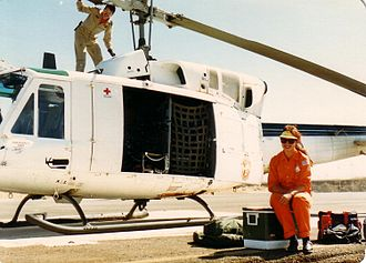 Multinational Force and Observers - Canadian CH135 Twin Huey helicopter and an MFO Observer wearing the distinctive orange uniform used in 1989