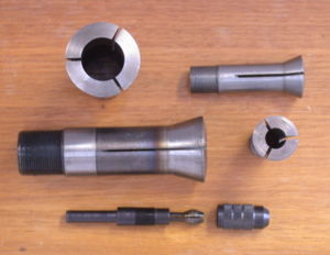 Collet - Several machine collets (top and centre) and a dismantled pin chuck (below).