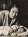 Madame Wellington Koo (née Hui-lan Oei) with baby.jpg