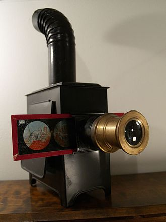 Magic lantern - 19th century magic lantern with printed slide inserted (upright, so if the lantern were lit it would project an inverted picture)