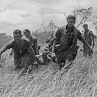2nd Battalion, 9th Marines - Marines of E/2/9 carry a wounded Marine to a MEDEVAC helicopter during Operation Hickory III
