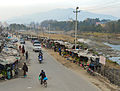 Market stalls on the Bagmati river (12679670735).jpg