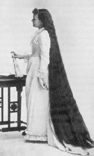 Martha Matilda Harper - Harper's own hair was the greatest advertisement for her products and services. This iconic image, and others in a similar pose, appeared in much of her early advertising.