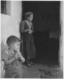 Matera, Italy. Still unaware of despair, a small boy of Matera, Italy, unconsciously repeats the gesture of his... - NARA - 541739.tif