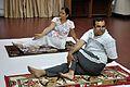 Mrs Manekar and Anil Shrikrishna Manekar - Vakrasana - International Day of Yoga Celebration - NCSM - Kolkata 2015-06-21 7375.JPG