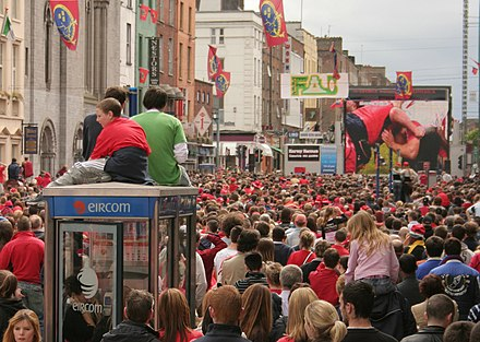 Munster fans watch their team in the 2005-06 Heineken Cup on a jumbo screen on the streets of Limerick. Munster rugby 2006.jpg