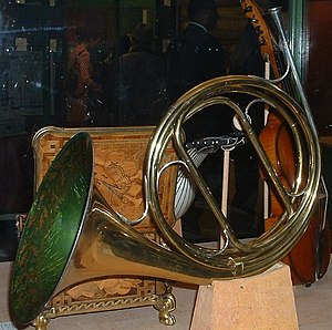 French horn - A natural horn has no valves, but can be tuned to a different key by inserting different tubing, as during a rest period.