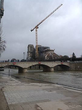 Stabilization of Notre Dame and removal of roof debris and scaffolding (29 February 2020) Notre Dame restoration long view Feb 29 2020.jpg