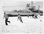 Operation Windmill Expedition Members Playing in the Snow (5243862780).jpg