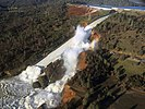Water flowing from Oroville Dam's eroded spillway