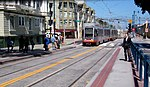 Outbound N Judah train at Duboce and Church, September 2012.jpg