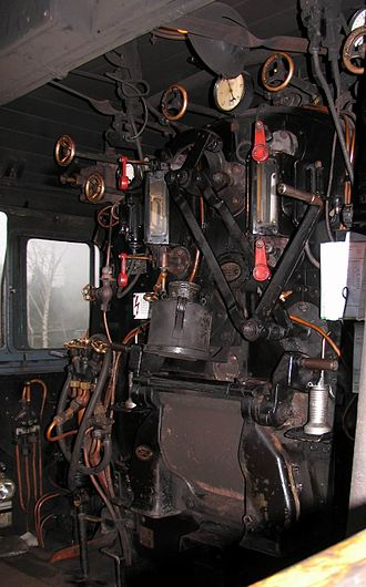 Cab (locomotive) - Cab of a German steam locomotive, view of the fireman's side.  In the right middle of the image is a clamped driver's timetable, below that the firebox door can be seen.
