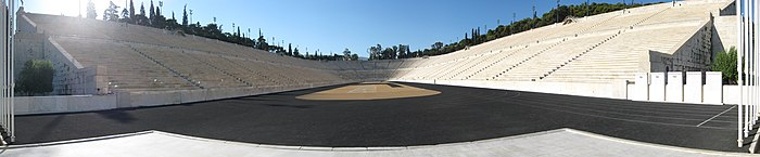 Panorama of a U-shaped stadium of white marble