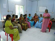 A group of women in India receiving instruction in health education