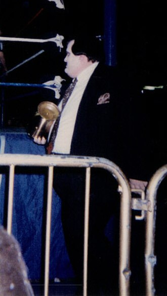 Manager (professional wrestling) - Paul Bearer carrying the urn he used to control The Undertaker