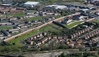 Peace lines walls in Northern Ireland separating nationalist and unionist neighborhoods